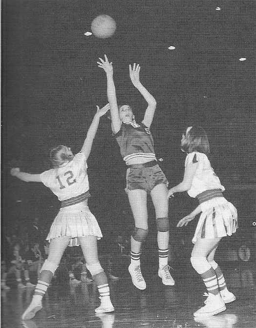 Denise Long shooting over Lynda Nordstrum, number 12, and Judy Walton, of Everly High in 1968 overtime championship game.