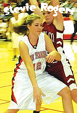 Image of Stevie Rogers, Powell County High (Kentucky) girls basketball player (#12) dribbling around Harrison County defender.