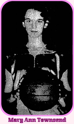 Image of girl basketball player, Mary Ann Townsend, Lumberton High School Lady Pirates (North Carolina), facing front, holding basketball at waist. From The Robesonian, Lumberton, N.C., December 7/1954, DEcember 23, 1954.
