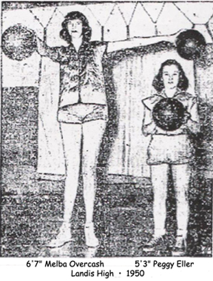 Me;ba Overcash holds two basketballs, one of them towering over the head of Landis High School basketball teammate, Peggy Ellis, in 1950. This was year Melba Overcash scored 102 points in one game for Landis.