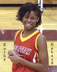 Image of a happy Ruthy Hebard, West Valley High girls basketball player (alaska). In red Wolfpack uniform.