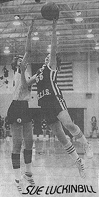 Image of Sue Luckinbill, Guthrie Center basketball player (Iowa), shooting a layup high above 6-foot 1-inch Jana Harberts of Walnut High. Date and newspaper unknown.