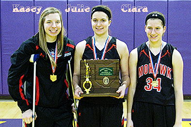 Adelsperger triplets, Mohawk High (Ohio) basketball players, standing with awards. Kasey on crutches, Julie, and Clara (number 34).