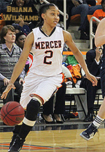 Briana Williams, Mercer College women's basketball player, dribbling ball.