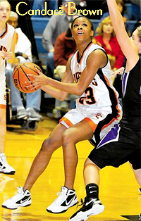 Picture of Candace Brown, Summers County High (West Virginia) basketball player, in action shot trying to shoot while guarded.