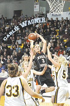 Carlie Wagner, shooting aty the basket for the NRHEG Panthers.