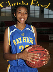 Image of Christa Reed, Bay High, Mississppi, basketball player, holding basketball in her yellow on blue uniform.