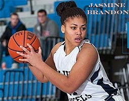 Jasmine Brandon, College of New Rochelle Blue Angel. number 31, with ball, looking to pass.