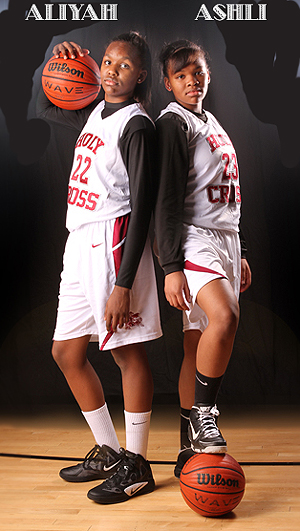 The Jeune sisters when at Holy Cross in Burlington, New Jersey, Aliyah, number 22, Ashli (number 23), back to back.