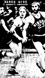 Image of Karen Wise, Windham College baasketball player, playing with male teammates in game. She is running downcourt with two of her bearded teammates on either side. From The Kingsport News. Kingsport, Tennessee, January 28, 1972.