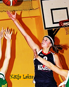 Image of Kitija Laksa, Kolibri-47.vsk C2 (Latvia) girls basketball player reaching up after releasing the ball towards the basket. girlsbasket.eu Foto.