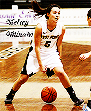 Kelsey Minato, West Point female basketball player, Lady Black Knight number 5, dribbling ball between her legs in game action photo from the U.S. Military Academy at West Point.