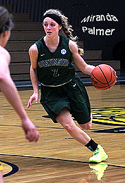 Miranda Palmer, Huntington University basketball player, dribbling the ball, charging in to shoot. Number 2.
