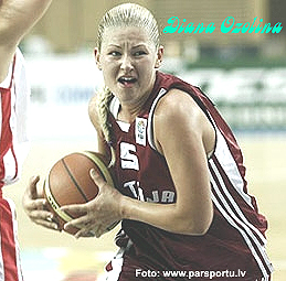 Diana Ozolina, RCHV basketball player, in later photograph (from http://www.parsportu.lv ), driving up the court, sternly.