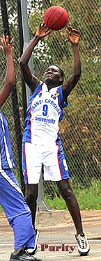 Image of Purity Odhiambo (aka Adhiambo), #9 for the Uganda Christian University women's basketball team, shooting against IUIU on March 29, 2014. Photo (cropped) by John Batanude.