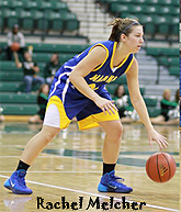 RAchel Melcher, basketball player for Maddona University Crusaders, dribbling ball in blue uniform with yellow trim.