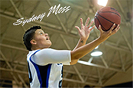 Picture of Sygney Moss going up for a shot. Thomas More College woman basketball player, who just set a single-game NCAA Division III scoring record of 63 pts, NFL great Randy Moss's daughter.