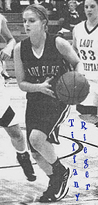Image of Tiffany Rieger, Burlington Lady Elk (Oklahoma) basketball player, driving with the ball. Froom The Kiowa News, Kiowa, Kansas, December 19, 2012..