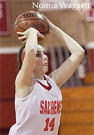 Norma Waggett, Saugus High School Sachems basketball player, in Massachusetts, number 14, shooting a basket.