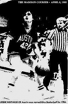 Image of Jodie Whitaker, Austin Lady Eagle basketball player (Austin, Indiana), in game action with ball. From The Madison Courier, Madison, Indiana, April 8, 1985.