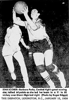 Action shot of Barbara Parks, Central High Lady Spartan, in action from January 14, 1958 game where she scored 64 points. From The Dispatch, Lexington, North Carolina, January 15, 1958. Text: STAR SCORER--Barbara Parks, Central High's great scoring star, tallied 64 points as she led her team to a 91 to 80 victory over Glenn High last night.  (Photo by Roger Briggs)