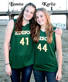 Photo of Bonnie and Karlie Samuelson in uniform, on beach.