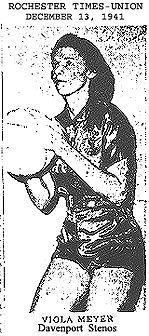 Viola Meyer, basketball in haand, satin uniform, Davenport Stenos, All-American, picture from the Rochester Times-Union, East Rochester, New York, December 13, 1941.