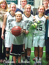 Picture of the Veroneau sisters, Wynflete Flyers basketball players (Maine), brother with ball, with family, cropped from larger image. Martha, number 12. Catherine, number 22. Those two are twins. Anne is number 25 and a freshman.