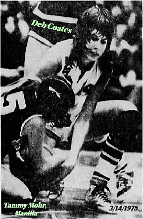 Picture from The Quad-City Times, DAvenport-Bettendorf, Iowa, March 14, 1975, of Deb Coates (Who scores 56 points in this state playoffs quarterfinal game), fighting for the ball on the ground, trying to grab it from Tammy Mohr of the losing Manilla team. (Final score 75-63). GAme played 3/13/1975..