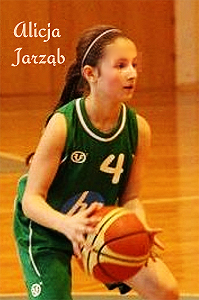 Alicja Jarzab, UKS Piomar Brzeg U13 girls basketball player while scoring 69 pts. With basketball, wearing green uniform, number 4.