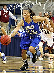 Image: Alysha Clark dribbling ball heading upcourt in her blue Middle Tennessee basketball uniform, #22, in 2010