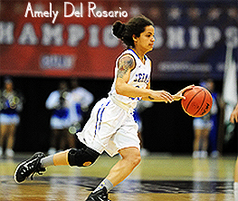 Image of Amely Del Rosario, Lehman College women's basketball player, 2ith basketball coming up court.