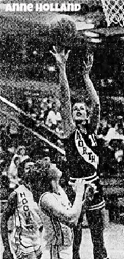 Image of Iowa high school girls basketball player, Anne Holland, taking a jump shot in a game in a game on 1/8/1982. North High School player, photo by Doug Wells. The Des Moines Register, Jan. 9, 1982.