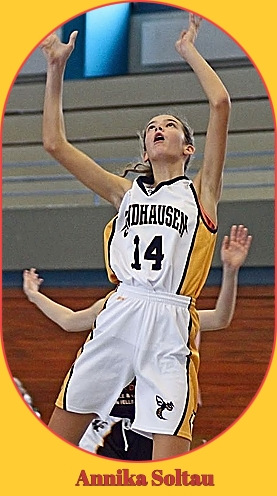 Image of Annika Soltau, girls basketball player on TG Sandhausen, in Baden-W�rttemberg' Regionaliga U14 JRL, 2017-18 in white #14 uniform going up for shot.
