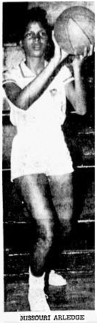 Photograph of Missouri 'Big Mo' Arledge, Philander-Smith College basketball player shooting a basketball. From the St. Joseph News-Press, St. Joseph, Missouri, March 2, 1955.