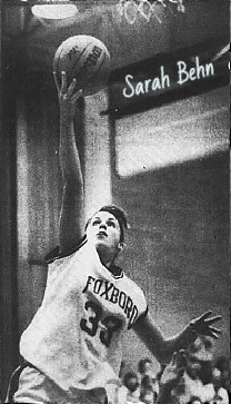 Sarah Behn, Foxboro High School girls basketball player (Massachusetts), shooting a lay-up under the basket in a FOXBORO uniform, #33. From The Boston Globe, February 25, 1989.