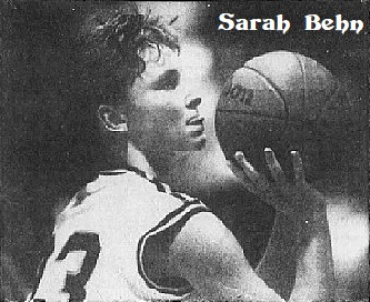 Black and white image of Massachusetts girl basketball player, Sarah Behn of Foxboro High School, shooting a foul shot to our right, while biting her tongue. From The Boston Globe, JAnuary 15, 1989. Photo by John Blanding.