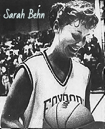 Sarah Behn, girls basketball player for Foxboro High School following her breaking the Massachusetts state record for career points on February 3, 1989. In uniform, with basketball, looking down and smiling. From The Boston Globe, Feb. 4, 1989. Photo by Suzanne Kreiter.