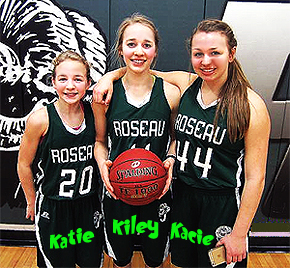 Three Borowicz sisters, girls basketball players on the Roseau Rams high school (Minnesota) team. #20 Katie, #11 Kiley (with basketball), #14 Katie, in green uniforms.
