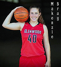 Image of Makenzie Bray, girls basketball player for Glenwood High in Chatham, Illinois. Posing with bent right arm holding basketball on shoulder, in red Glenwood uniform, number 10.