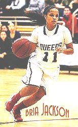Bria Jackson, Queens College basketball player, dribbling the ball upcourt in a game.
