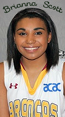 Portrait photo of women's basketball player Brianna Scott of Old College, in a white uniform jersey with BRONCOS in black outlines yellow letters, blue 'acac' on left shoulder, and a red symbol (unidentified) off right shoulder.