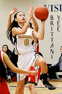 Brittani Yee, Gleneagle Secondary School (British Columbia) girls basketball player, #8, in a white uniform with gold lettering, going up for a shot.