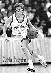 Carla Beattie, as University of Montana Grizzlie, dribbling ball upcourt.