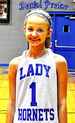 Image of Daniel Prater, 8th grade girl basketball player on the Phelps High School Lady Hornets basketball team in Augusta, Georgia, 2015-16; in a LADY HORNETS uniform blue lettering on white, number 1.