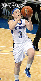 Image of Darby Maggard, Indiana girls basketball player, #3, going up for a basket for Canterbury High School.