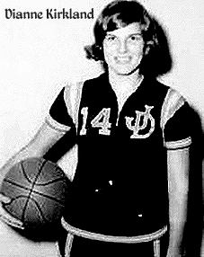 Picture of Dianne Kirkland, Jefferson Davis High School girls basketball player (Georgia 6 a side), posing in uniform, interlocking JD and #14, holding basketball to right hip.