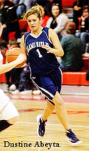 Dustine Abeyta, Alamo Navajo basketball player (New Mexico), number one, driving up court with basketball.