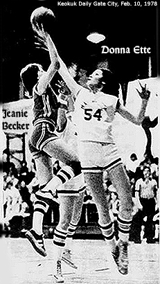 Image of Donna Ette, Cardinal Stritch High School (Iowa), #54, going up for a one hand shot being guarded by Marquette's Jeanie Becker, during Ette's 47 point game, 2/9/1976. From the Keokuk Daily Gate City, February 10, 1976.