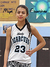 Image of Mya Fourstar, Frazer High girls basketball player (Montana), posing in white uniform with black lettering, Lady Bearcubs #23.
